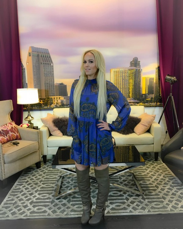 On set In a dress by Free People provided by RentTheRunway boots Jessica Simpson