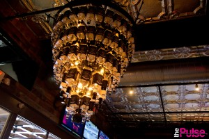 chandelier made of 10o bottles of drained Jack Daniels