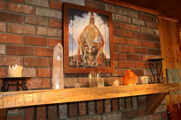 Crystals & art on fireplace