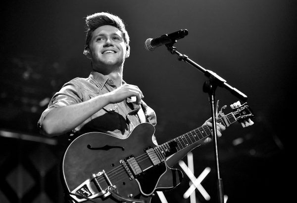 LOS ANGELES, CA - DECEMBER 02:  (EDITORS NOTE: Image has been converted to black and white.) Singer Niall Horan performs onstage during 102.7 KIIS FM's Jingle Ball 2016 presented by Capital One at Staples Center on December 2, 2016 in Los Angeles, California.  (Photo by Mike Windle/Getty Images for iHeartMedia)