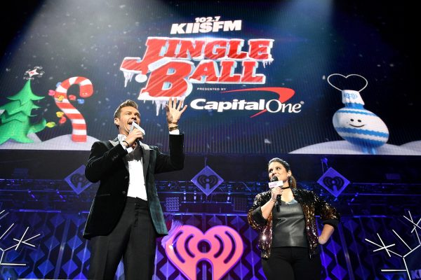 LOS ANGELES, CA - DECEMBER 02:  Host Ryan Seacrest (L) and radio personality Sisanie speak onstage during 102.7 KIIS FM's Jingle Ball 2016 presented by Capital One at Staples Center on December 2, 2016 in Los Angeles, California.  (Photo by Mike Windle/Getty Images for iHeartMedia)